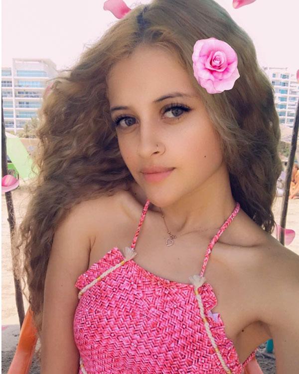 Alana wearing a pink bikini