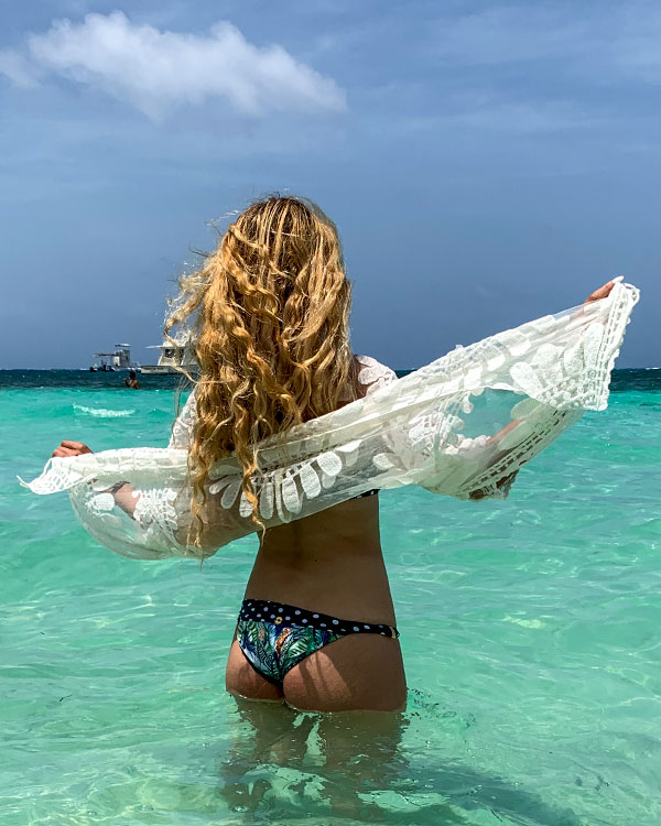 Alana rear view standing in the sea