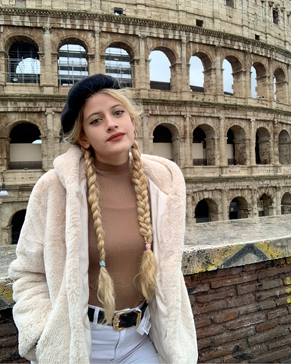 Alana in front of the Colloseum in Rome